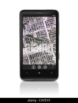 Windows 7 phone. HTC HD7 smartphone with Bing maps GPS navigation on its display isolated on white background - Stock Photo
