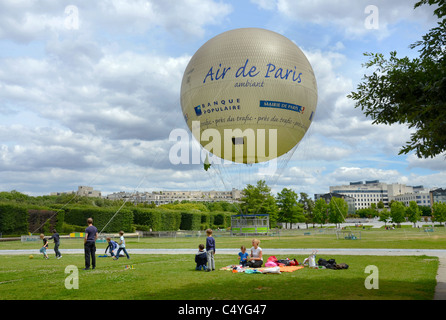 The Parc André Citroën, complete with a tethered hot air balloon allowing visitors to rise above the Paris  skyline. - Stock Photo