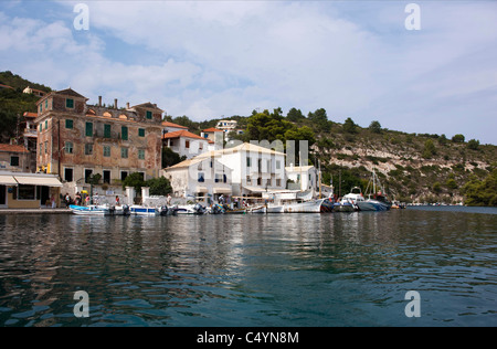 The old governor's house (left) on the waterfront in Gaios. Paxos, Greece. - Stock Photo