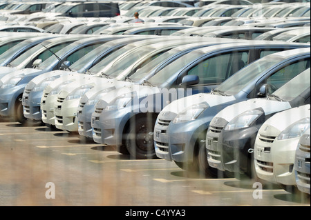 Lines of a new imported exported cars in a sea port - Stock Photo