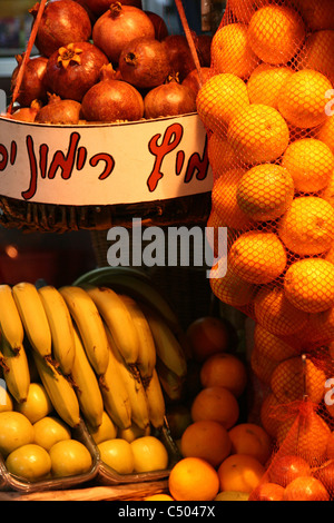 Different fruits displayed in a fruit stall in the center of Tel Aviv, Israel. - Stock Photo