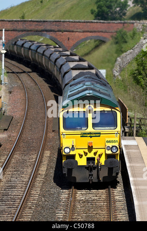 Freight Liner Wagons _Transporting Coal by British Railways _Coal Hoppers & Goods train at Tebay Station, Settle - Stock Photo