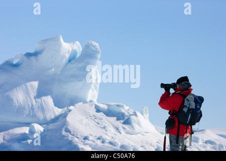 Tourist photographing iceberg, Snow Hill Island, Antarctica - Stock Photo