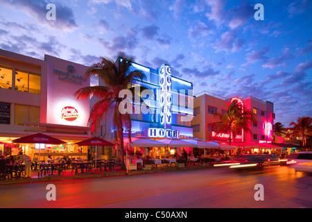 Art Deco Neon lit historic buildings, Ocean Drive, Miami South Beach, Florida - Stock Photo