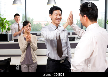 Office workers celebrating success