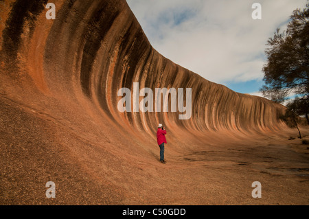 Photographing Wave Rock a natural geological formation near Hyden in Westen Australia - Stock Photo