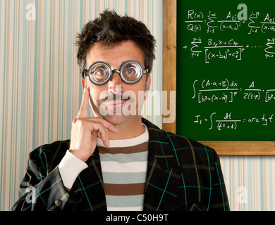 Genius nerd glasses silly man board math formula pensive gesture thinking expression - Stock Photo