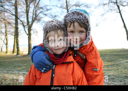 Children in winter clothes - Stock Photo