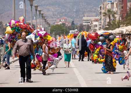 balloon vendor on the harbour promenade of the coastal port city Volos, Thessaly, Greece - Stock Photo