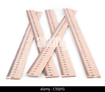 few wooden rulers isolated on white background - Stock Photo