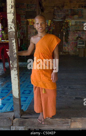 Novice Buddhist monk, Wat Lolei, near Siem Reap, Cambodia - Stock Photo