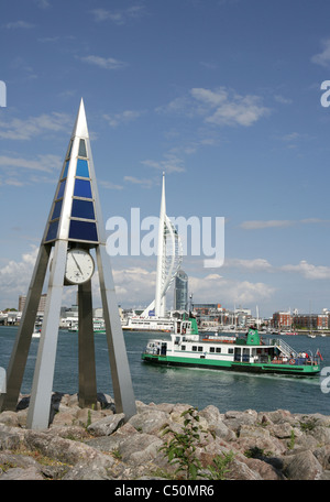 Gosport ferry with maritime clock in foreground and spinnakar tower in background - Stock Photo