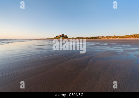 The beach and castle at Bamburgh - Stock Photo