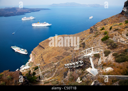 Santorini typical iconic Greek Island cable car ride to cruise ships on the caldera at Thira - Stock Photo