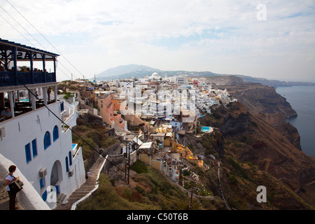 Santorini typical iconic Greek Island high up looking at Thira town and the caldera - Stock Photo