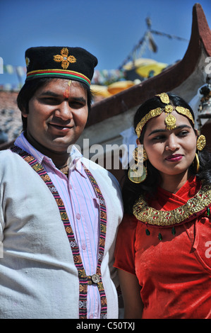 Bride and groom posing before their wedding celebrated at Boudhanath, Kathmandu Valley - Stock Photo