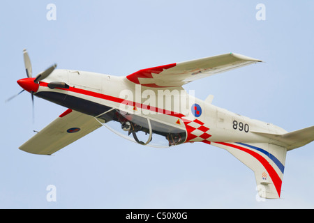 'Wings of storm' (Krila oluje), one of Croatian air force aerobatic team aircraft is flying inverted - Stock Photo