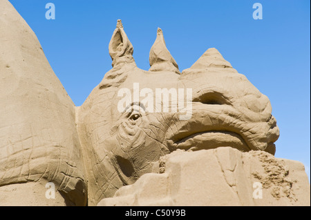 Rhino head at Sand Sculpture Festival on beach seafront at Weston Super Mare Somerset South West England UK - Stock Photo