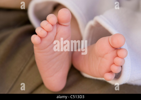 Baby's bare feet - Stock Photo