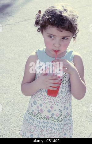 Little girl drinking juice - Stock Photo