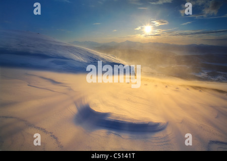 A blizzard on Toviktinden Mountain in Troms County, Norway. A view looking out towards Tjeldsundet towards the Lofoten - Stock Photo