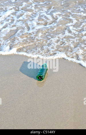 Plastic bottle washed up by the sea - Stock Photo