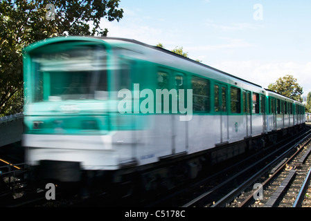 Train running on rail track - Stock Photo