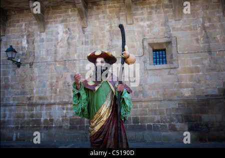 A mime dressed as St. James the Apostle stands in the Obradoiro square of Santiago de Compostela, Spain. - Stock Photo