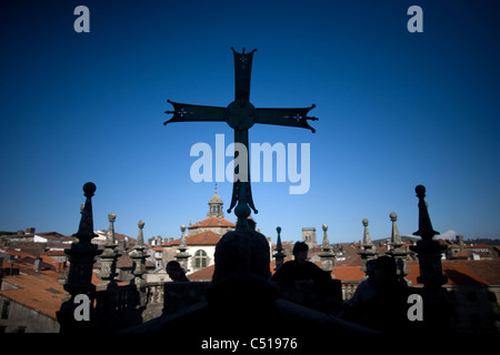 A medieval cross is displayed on the roof of the Cathedral of Santiago de Compostela, Spain. - Stock Photo