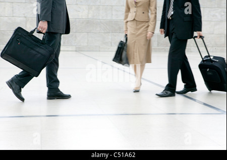 detail of business people with suitcases - Stock Photo