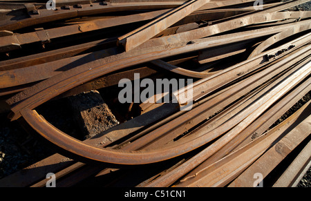 Inventory of decommissioned old railroad tracks collected as scrap metal - Stock Photo