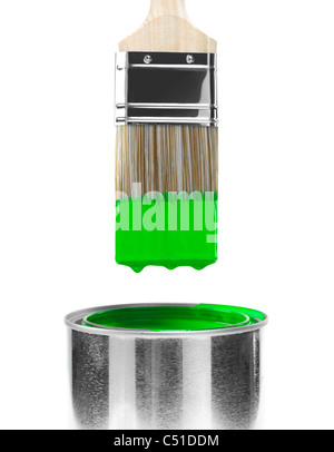 Painting brush dipped in can of green paint isolated on white background - Stock Photo