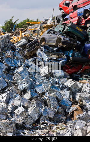 Unwanted old cars scrapped and crushed into cubes at recycling scrapyard. JMH5101 - Stock Photo
