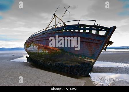 Shipwreck on the beach at Ettrick Bay, Isle of Bute, Argyll, Scotland. JMH5105 - Stock Photo