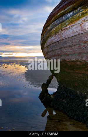 Shipwreck on the beach at Ettrick Bay, Isle of Bute, Argyll, Scotland at sunset. JMH5106 - Stock Photo