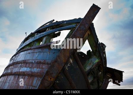 Shipwreck on the beach at Ettrick Bay, Isle of Bute, Argyll, Scotland. JMH5111 - Stock Photo