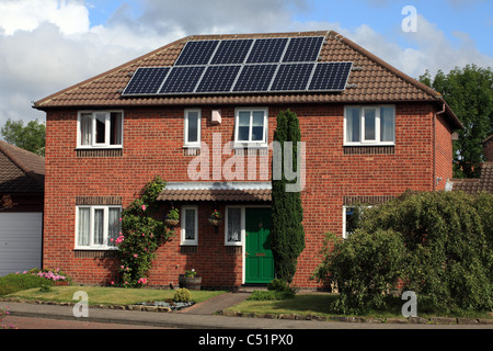 PV Photo voltaic Solar panels on detached house in England UK - Stock Photo