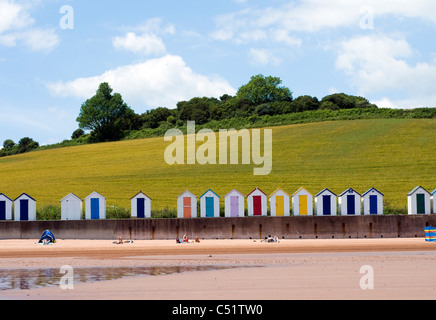 Broadsands beach,Beachhuts and green fields, BOATS, BLUE, SEA, SKY, SEASIDE, SCENE, SEASHORE, BATHERS, COASTAL, - Stock Photo