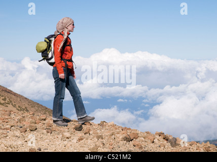 Woman standing above the clouds, Teide National Park, Tenerife, Canary Islands, Spain, Europe - Stock Photo