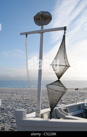 Boat with a fishing net on a beach in winter, Sierksdorf, Luebeck Bay, Baltic Sea, Schleswig-Holstein, Germany, Europe