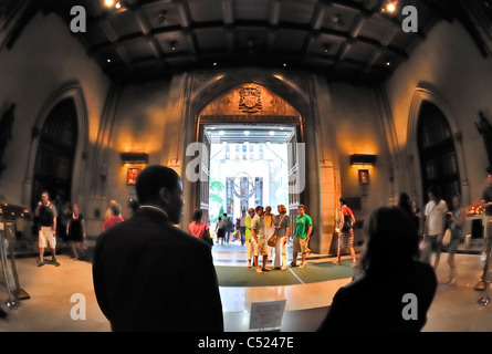 Inside St. Patrick's Cathedral lobby looking out to statue of Atlas, 5th Avenue, NYC, New York, USA, 2011 (fisheye - Stock Photo