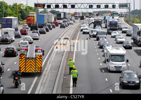 View from above looking down on busy M25 motorway traffic jam emergency services attend to two accidents on both - Stock Photo