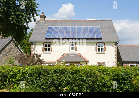 Solar panels on roof of detached house in village of Llangattock Powys South Wales UK - Stock Photo
