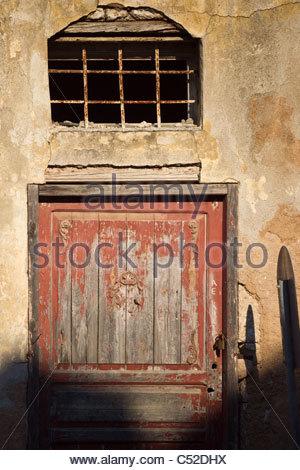 Ancient Greek village door Greece - Stock Photo