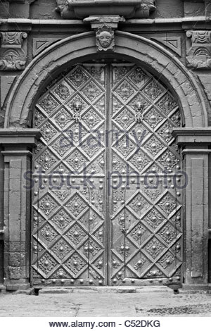 Intricately carved doors of the Igleisia Santo Domingo church in Huancavelica, Peru - Stock Photo