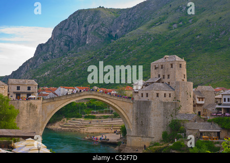 Stari Most the Old stone bridge crossing Neretva river central Mostar city Bosnia and Herzegovina Europe - Stock Photo