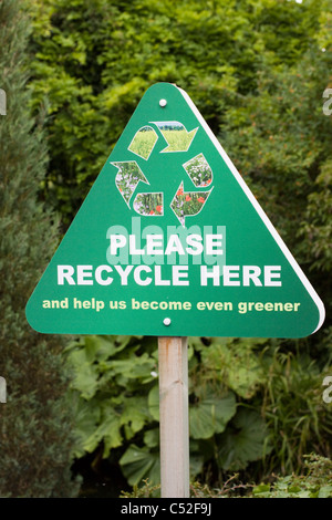 A Please Recycle Here Sign - Stock Photo