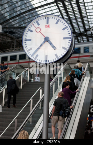 People on escalator to railway platform at the central station in Berlin, Germany. - Stock Photo