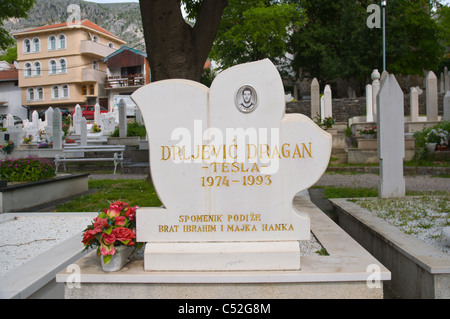 Grave of a young man who died during the war of 1990s in Muslim graveyard Mostar city Bosnia and Herzegovina Europe - Stock Photo
