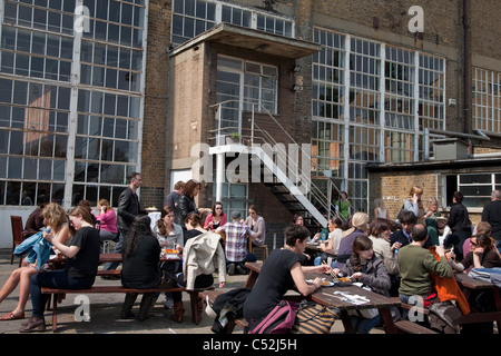 People Drinking in Bar at the Sunday Up Market, Old Truman Brewery, Brick Lane, London - Stock Photo